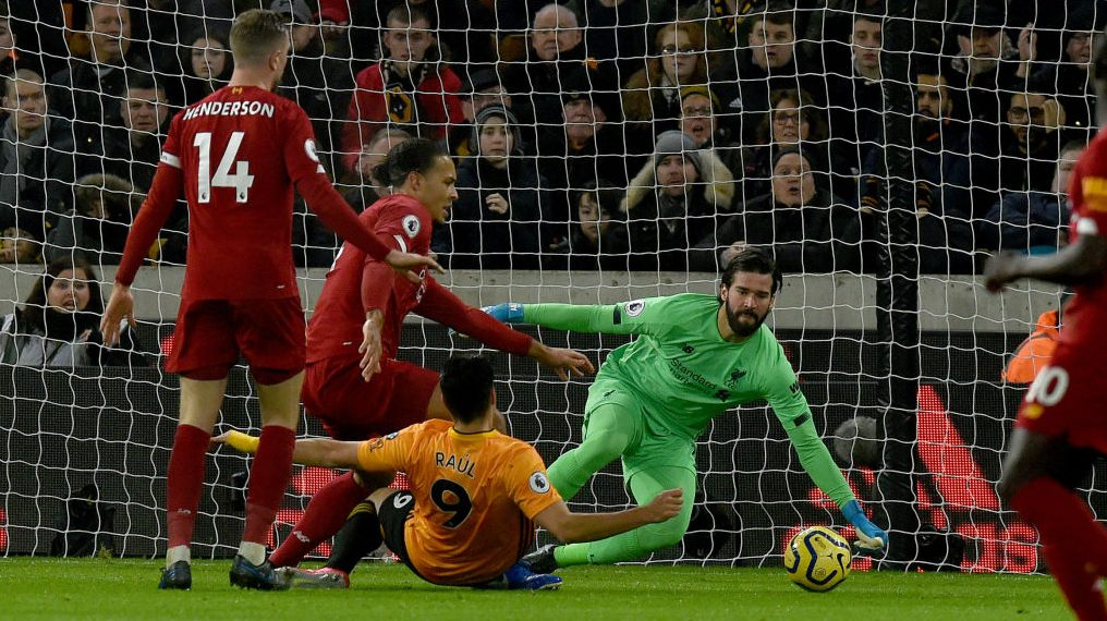 Liverpool overcomes Wolves challenge to win 14th-straight